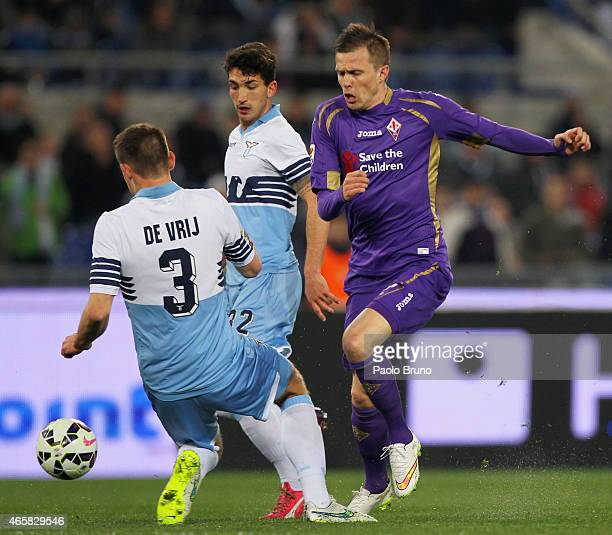Josip Ilicic of ACF Fiorentina competes for the ball with Stefan De Vrij of SS Lazio during the Serie A match between SS Lazio and ACF Fiorentina at...