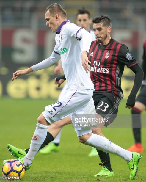 Josip Ilicic of ACF Fiorentina is challenged by Jose Sosa of AC Milan during the Serie A match between AC Milan and ACF Fiorentina at Stadio Giuseppe...