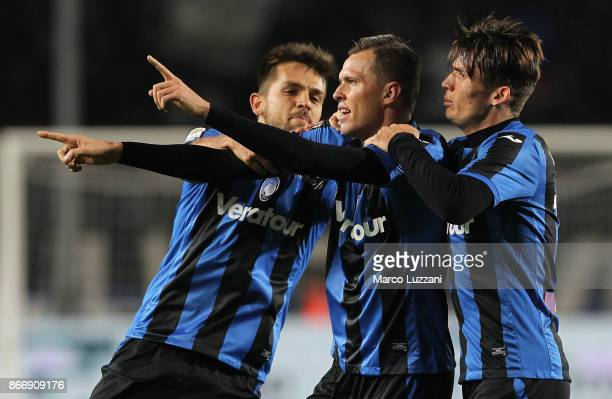 Josip Ilicic of Atalanta BC celebrates his goal with his teammates Rafael Toloi and Marten De Roon during the Serie A match between Atalanta BC and...