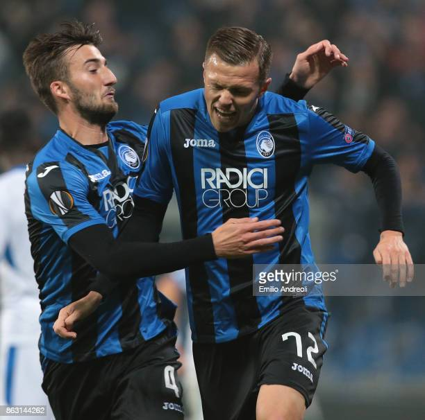Josip Ilicic of Atalanta BC celebrates with his teammate Bryan Cristante after scoring the opening goal during the UEFA Europa League group E match...