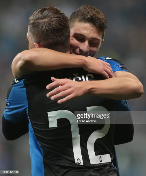 Josip Ilicic of Atalanta BC celebrates with his teammate Mattia Caldara after scoring the opening goal during the UEFA Europa League group E match...