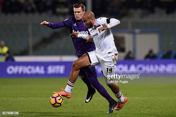 Josip Ilicic of Fiorentina and Haitam Aleesami compete for the ball during the Serie A match between ACF Fiorentina and US Citta di Palermo at Stadio...