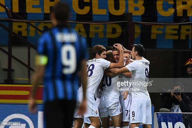 Josip Ilicic of Fiorentina celebrates with team mates after scoring the opening goal during the Serie A match between FC Internazionale Milano and...