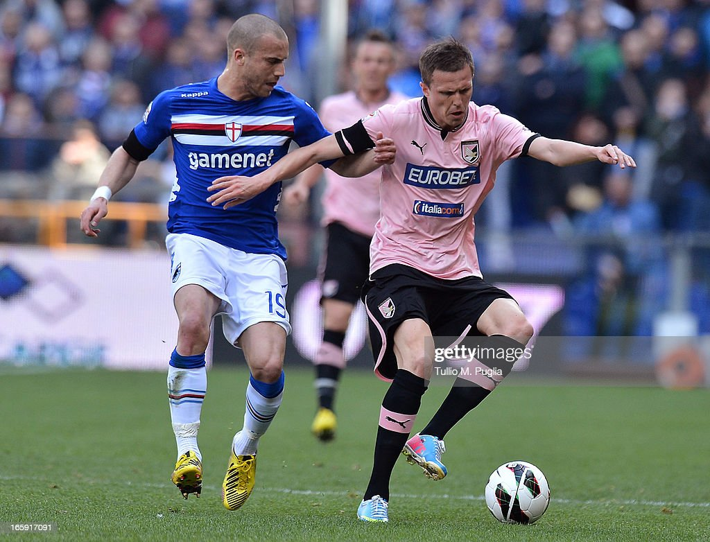<a gi-track='captionPersonalityLinkClicked' href=/galleries/search?phrase=Josip+Ilicic&family=editorial&specificpeople=7151628 ng-click='$event.stopPropagation()'>Josip Ilicic</a> (R) of Palermo and <a gi-track='captionPersonalityLinkClicked' href=/galleries/search?phrase=Lorenzo+De+Silvestri&family=editorial&specificpeople=4533237 ng-click='$event.stopPropagation()'>Lorenzo De Silvestri</a> of Sampdoria compete for the ball during the Serie A match between UC Sampdoria and US Citta di Palermo at Stadio Luigi Ferraris on April 7, 2013 in Genoa, Italy.