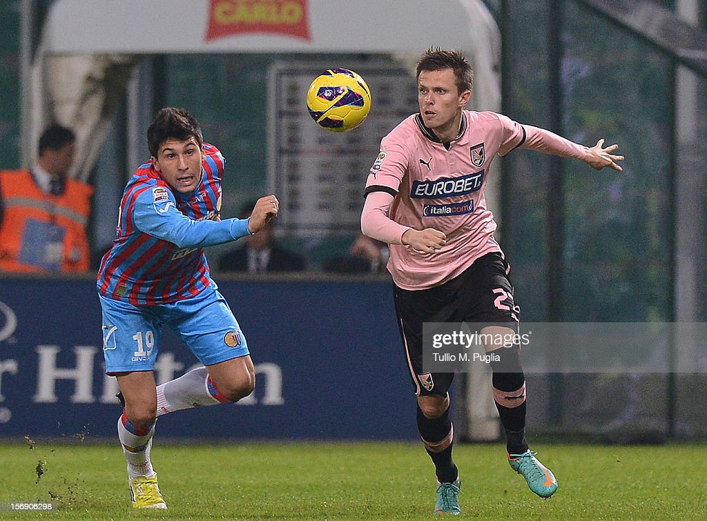 Josip Ilicic (R) of Palermo and Lucas Castro of Catania compete for the ball during the Serie A match between US Citta di Palermo and Calcio Catania at Stadio Renzo Barbera on November 24, 2012 in Palermo, Italy.