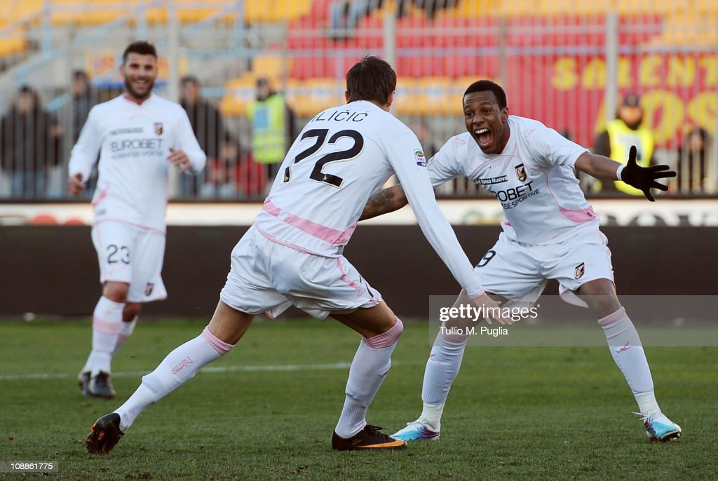 Josip Ilicic (C) of Palermo celebrates with his mates Abel Hernandez (R) and <a gi-track='captionPersonalityLinkClicked' href=/galleries/search?phrase=Antonio+Nocerino&family=editorial&specificpeople=675969 ng-click='$event.stopPropagation()'>Antonio Nocerino</a> (L) after scoring his team's fourth goal during the Serie A match between US Lecce and US Citta di Palermo at Stadio Via del Mare on February 6, 2011 in Lecce, Italy.