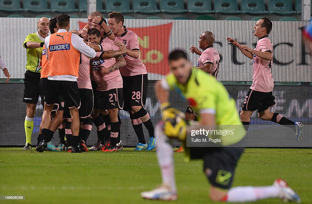 <a gi-track='captionPersonalityLinkClicked' href=/galleries/search?phrase=Josip+Ilicic&family=editorial&specificpeople=7151628 ng-click='$event.stopPropagation()'>Josip Ilicic</a> of Palermo celebrates with team mates after scoring is teams second goal during the Serie A match between US Citta di Palermo and Calcio Catania at Stadio Renzo Barbera on November 24, 2012 in Palermo, Italy.