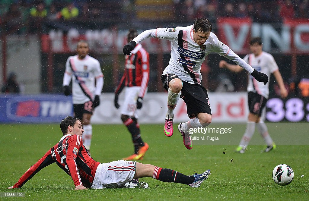 Josip Ilicic (R) of Palermo jumps as Mattia De Sciglio of Milan takles during the Serie A match between AC Milan and US Citta di Palermo at San Siro Stadium on March 17, 2013 in Milan, Italy.