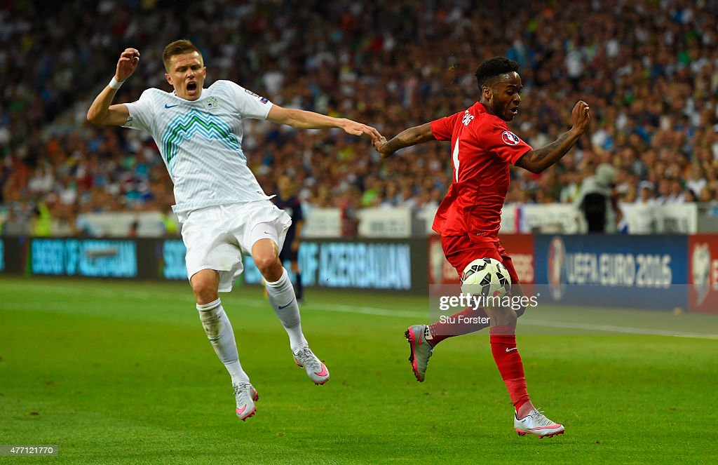 Josip Ilicic of Slovenia and Raheem Sterling of England battle for the ball during the UEFA EURO 2016 Qualifier between Slovenia and England on at...