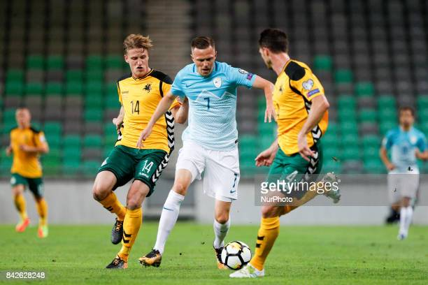 Josip Ilicic of Slovenia competes with Vykintas Slivka and Tadas Kijanskas of Lithuania during the FIFA 2018 World Cup Qualifier between Slovenia and...