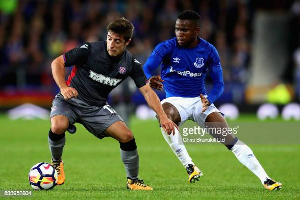 Josip Juranovic of Hajduk Split dribbles away from Ademola Lookman of Everton during the UEFA Europa League Qualifying PlayOffs round first leg match...