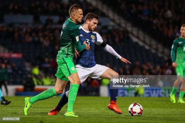Josip Licic of Slovenia and Andrew Robertson of Scotland during the FIFA 2018 World Cup Qualifier between Scotland and Slovenia at Hampden Park on...