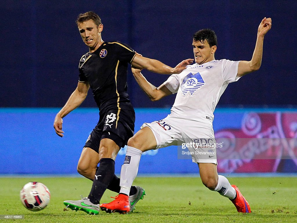 Josip Pivaric (L) of FC Dinamo Zagreb in action against Mohamed Elyounoussi (R) of FC Molde during the UEFA Champions League Third Qualifying Round 1st Leg match between FC Dinamo Zagreb and FC Molde at Maksimir stadium on July 28, 2015 in Zagreb, Croatia.
