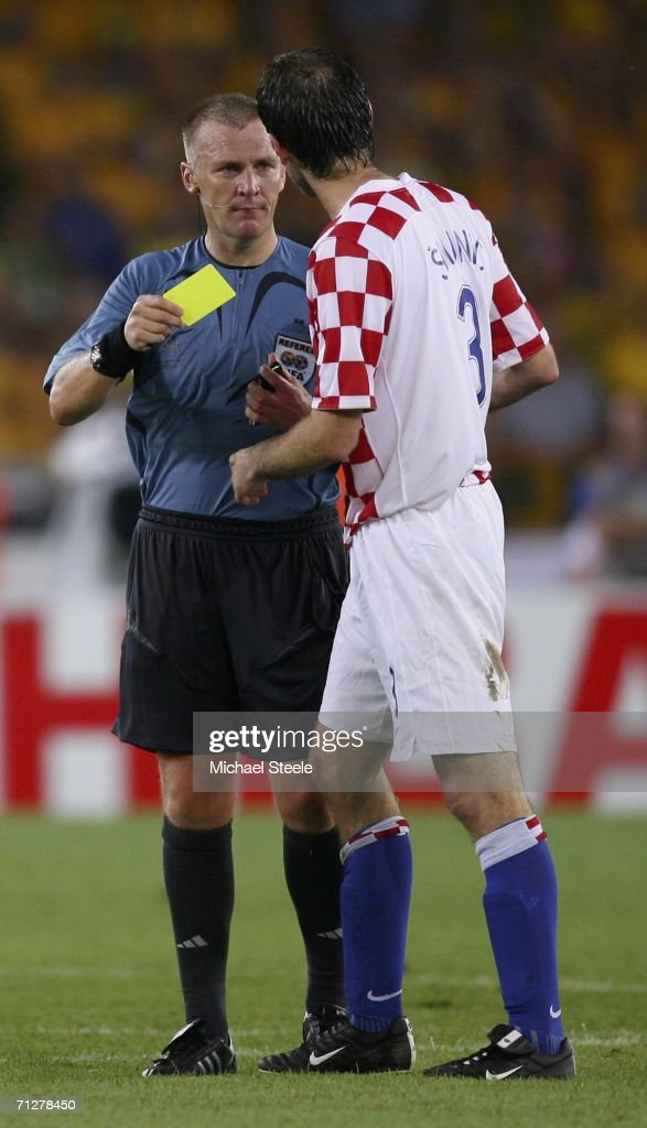 Josip Simunic of Croatia is shown a yellow card by English referee Graham Poll during the FIFA World Cup Germany 2006 Group F match between Croatia and Australia at the Gottlieb-Daimler Stadium on June 22, 2006 in Stuttgart, Germany.