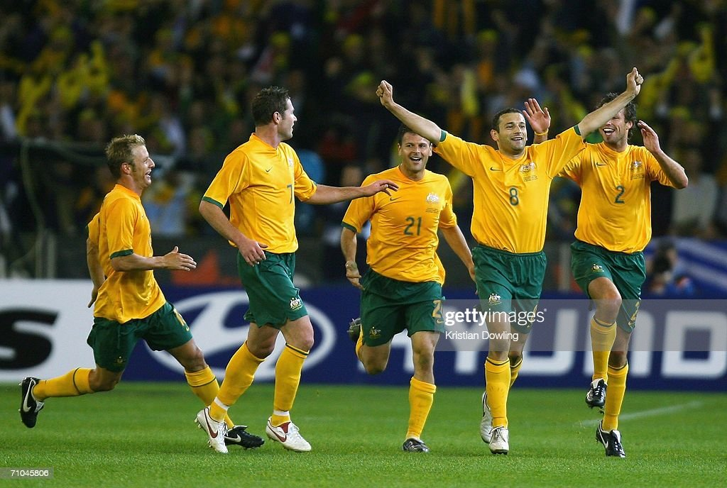 Josip Skoko of Australia celebrates with team-mates after scoring during the Powerade Cup international friendly match between Australia and Greece at the Melbourne Cricket Ground May 25, 2006 in Melbourne, Australia.
