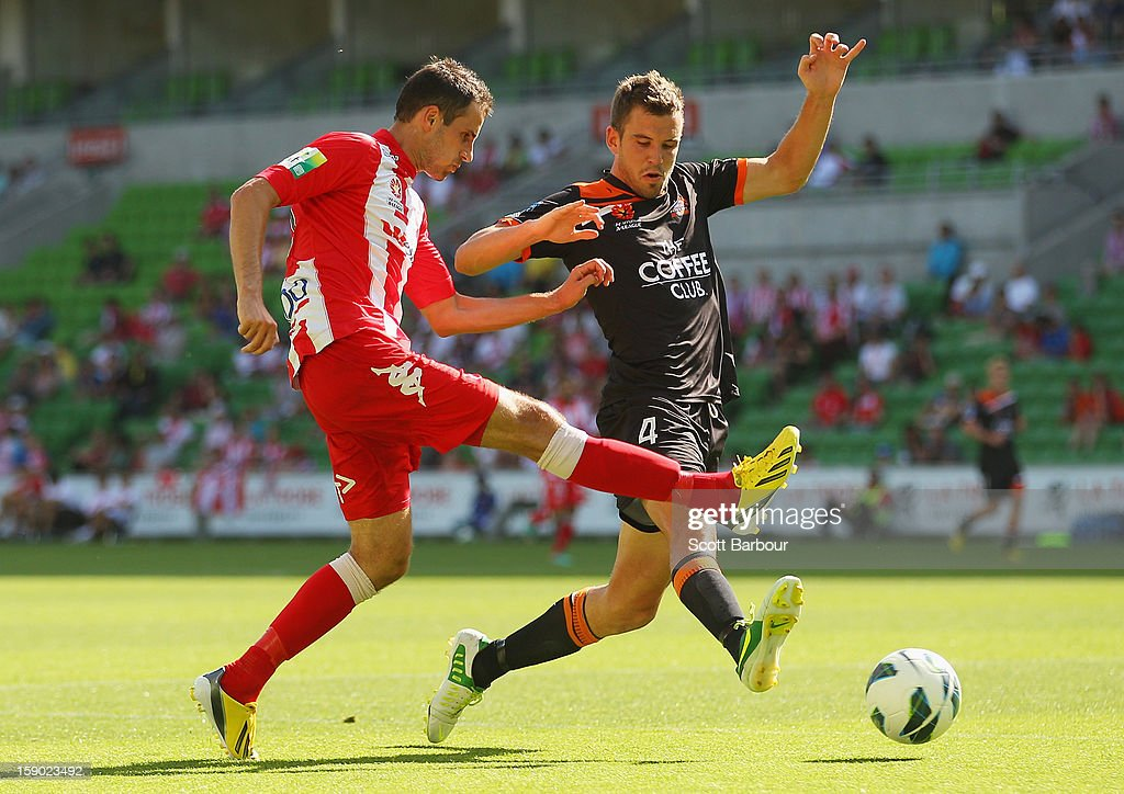 Josip Tadic of the Heart and Matthew Jurman of the Roar compete for the ball during the round 15 A-League match between the Melbourne Heart and the Brisbane Roar at AAMI Park on January 6, 2013 in Melbourne, Australia.