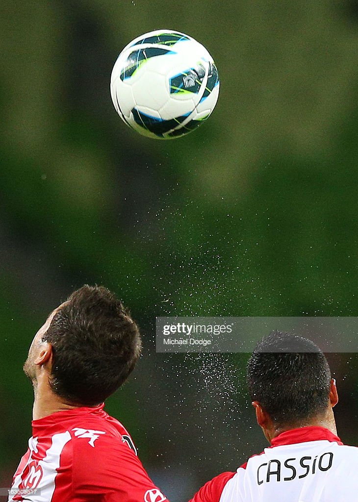 Josip Tadic (L) of the Heart contests for the ball against Cassio of Adelaide United during the round 24 A-League match between the Melbourne Heart and Adelaide United at AAMI Park on March 11, 2013 in Melbourne, Australia.