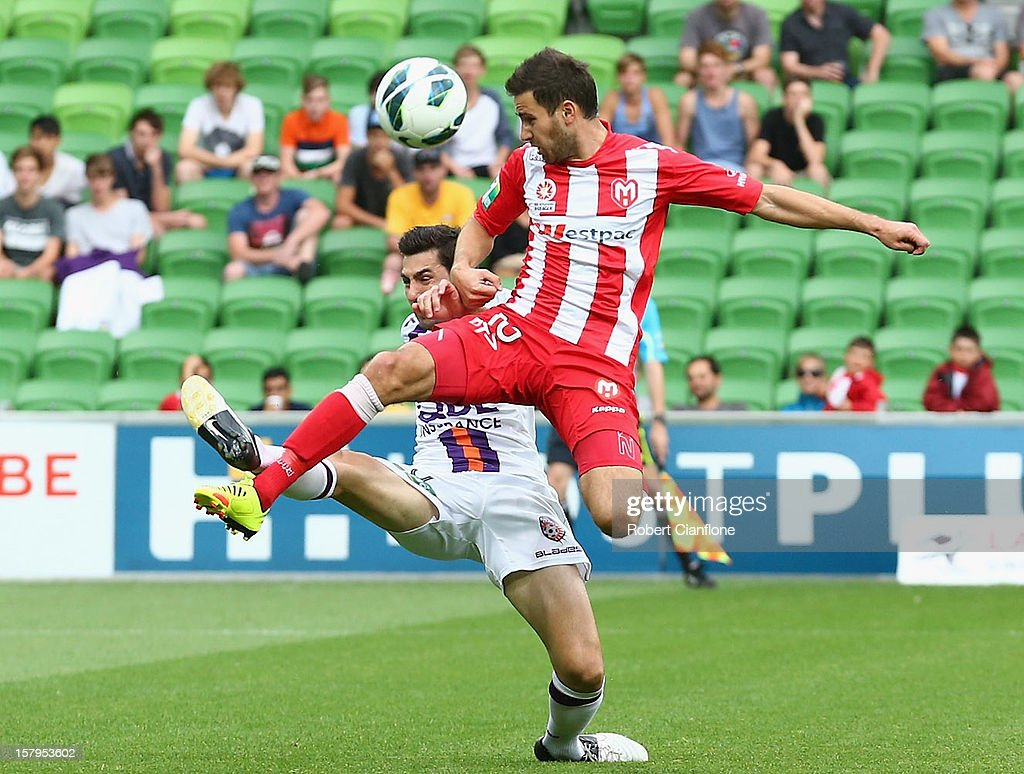 Josip Tadic of the Heart is challenged Steve Pantelidis of the Glory during the round 10 A-League match between the Melbourne Heart and the Perth Glory at AAMI Park on December 8, 2012 in Melbourne, Australia.