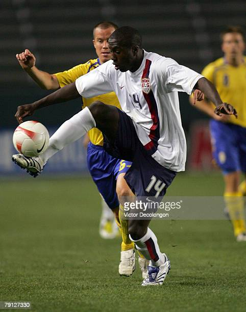 Josmer Altidore of the USA plays the ball from Daniel Andersson of Sweden in the second half during their International Friendly match at the Home...