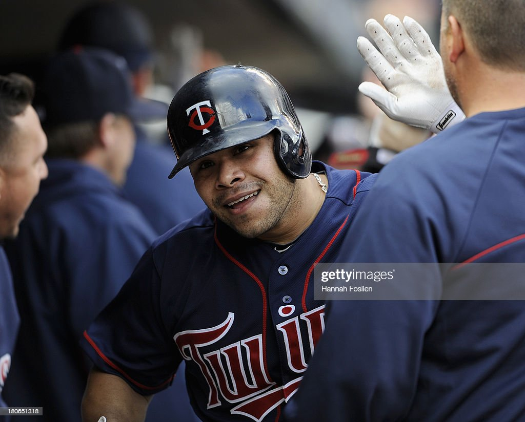 Josmil Pinto #43 of the Minnesota Twins celebrates hitting a three-run home run against the Tampa Bay Rays during the eighth inning of the game on September 15, 2013 at Target Field in Minneapolis, Minnesota. The Twins defeated the Rays 6-4.