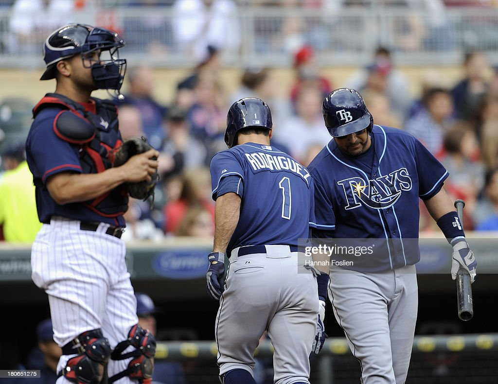 Josmil Pinto #43 of the Minnesota Twins looks on as <a gi-track='captionPersonalityLinkClicked' href=/galleries/search?phrase=Jose+Molina&family=editorial&specificpeople=206365 ng-click='$event.stopPropagation()'>Jose Molina</a> #28 of the Tampa Bay Rays congratulates teammate <a gi-track='captionPersonalityLinkClicked' href=/galleries/search?phrase=Sean+Rodriguez&family=editorial&specificpeople=4171805 ng-click='$event.stopPropagation()'>Sean Rodriguez</a> #1 on solo home run during the fifth inning of the game on September 15, 2013 at Target Field in Minneapolis, Minnesota. The Twins defeated the Rays 6-4.