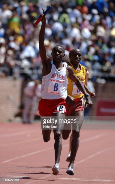 Josphat Boit of Arkansas celebrates after overtaking Richard Kiplagat of Iona on the anchor of the 4 x mile relay in the 112th Penn Relays at the...