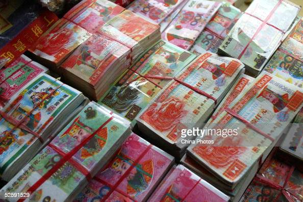 Joss papers used in worship ceremonies are seen sold at shops on the Qingming Festival also known as the 'Tomb Sweeping Day' April 5 2005 in Shenzhen...