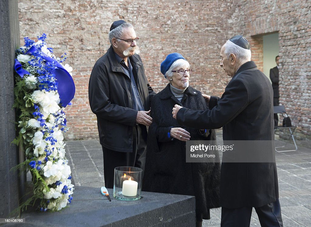 Jossef Avi Yair Engel and holocaust survivor Stelly Menco Ricardo are greeted by visiting Israeli President <a gi-track='captionPersonalityLinkClicked' href=/galleries/search?phrase=Shimon+Peres&family=editorial&specificpeople=201775 ng-click='$event.stopPropagation()'>Shimon Peres</a> at the Dutch Theatre (Hollandsche Schouwburg) on September 29, 2013 in Amsterdam, Netherlands. The theatre was used as a location to deport Jews in the second World War and is now a monument. Peres is on an official four day visit to the Netherlands.