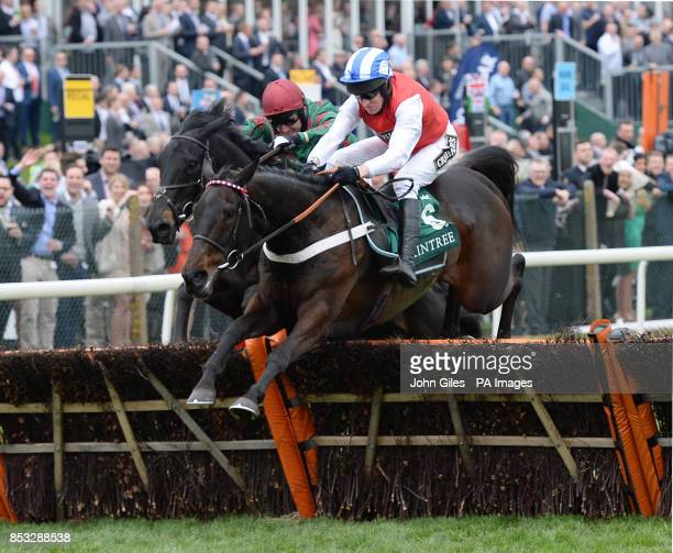 Josses Hill and Barry Geraghty win the International Festival for Buisness 2014 Top Novices Hurdle during Ladies Day of the Crabbie's Grand National...