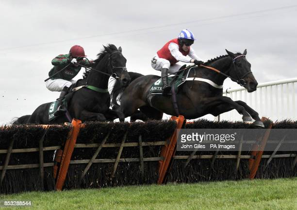 Josses Hill and Barry Geraghty win the International Festival For Buisness 2014 Top Novices Hurdle Race during Ladies Day of the Crabbie's Grand...