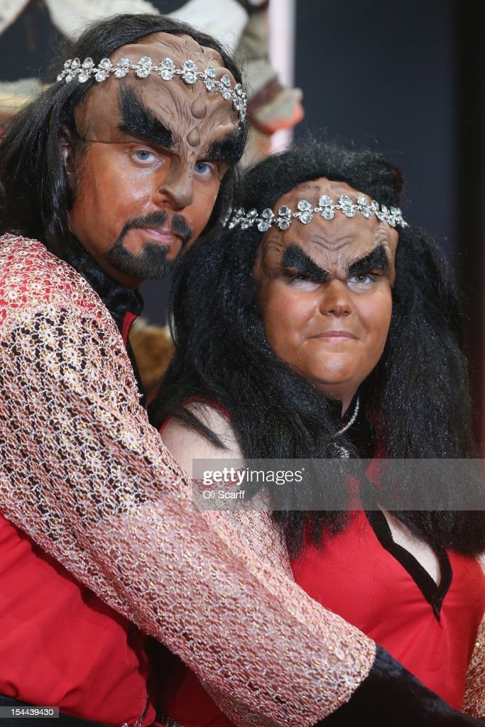 Jossie Sockertopp (R) and Sonnie Gustavsson from Sweden tie the know in a Klingon wedding at the 'Destination Star Trek London' convention at the ExCeL centre on October 19, 2012 in London, England. The three-day convention, which opened to the general public today, will be attended by all fives actors who played captains throughout the 46 year-old series.