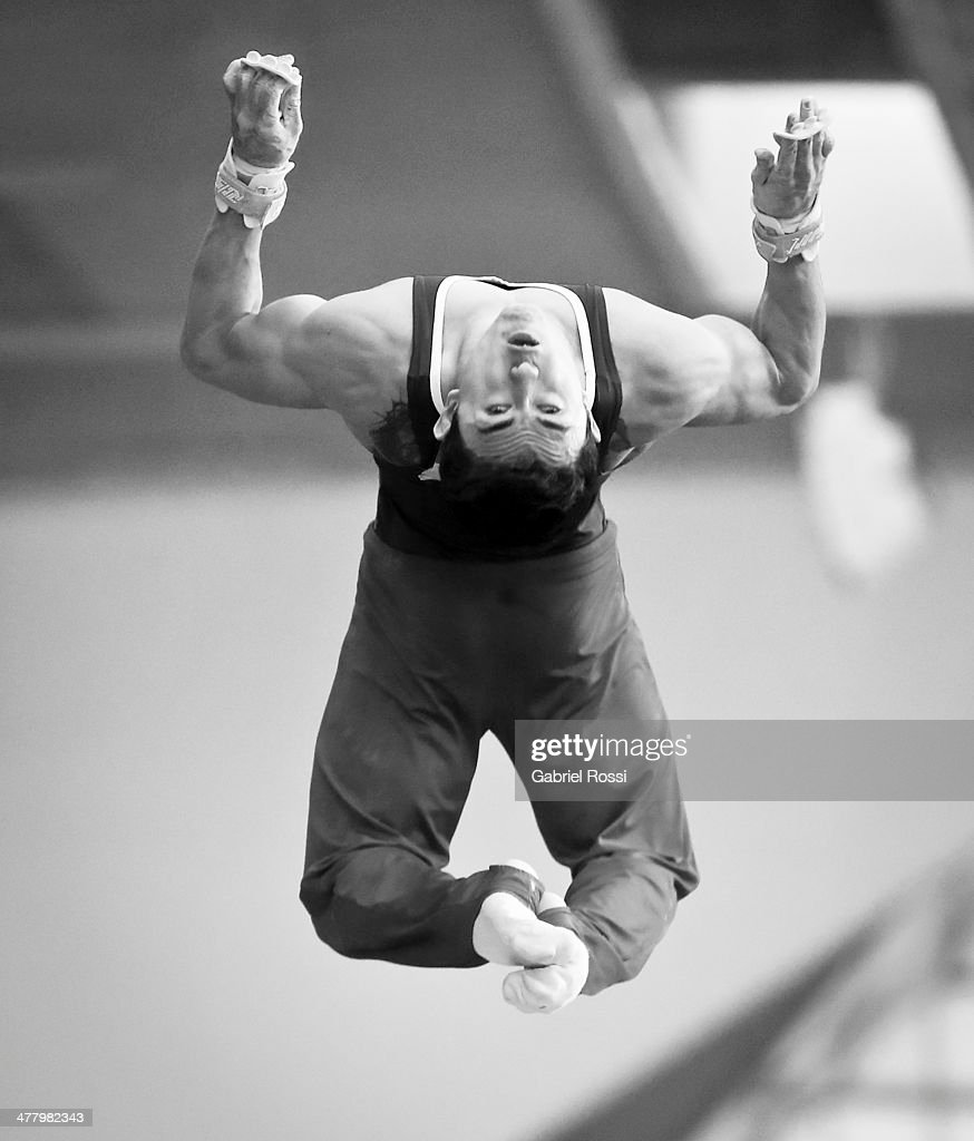 <a gi-track='captionPersonalityLinkClicked' href=/galleries/search?phrase=Jossimar+Calvo+-+Gymnast&family=editorial&specificpeople=8573046 ng-click='$event.stopPropagation()'>Jossimar Calvo</a> of Colombia competes in the Men's High Bar during day five of the X South American Games Santiago 2014 at Gimnasio Polideportivo Estadio Nacional on March 11, 2014 in Santiago, Chile.
