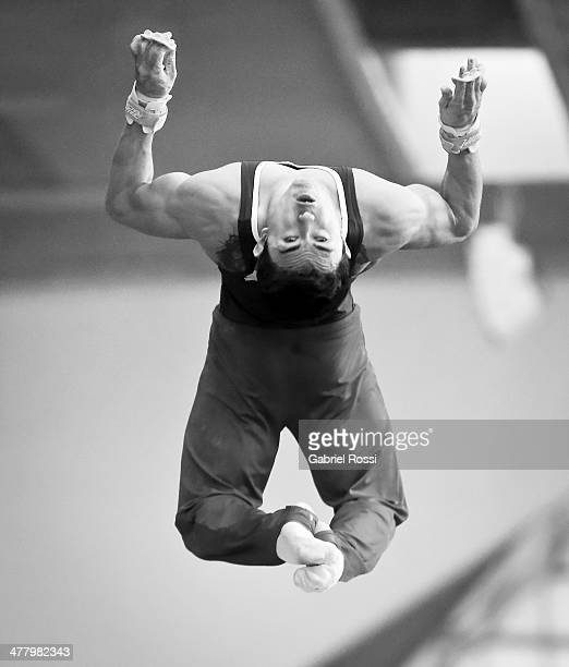 Jossimar Calvo of Colombia competes in the Men's High Bar during day five of the X South American Games Santiago 2014 at Gimnasio Polideportivo...