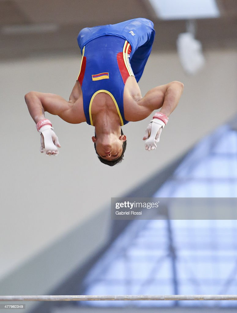 <a gi-track='captionPersonalityLinkClicked' href=/galleries/search?phrase=Jossimar+Calvo+-+Gymnast&family=editorial&specificpeople=8573046 ng-click='$event.stopPropagation()'>Jossimar Calvo</a> of Colombia competes in the Mens High Bar during day five of the X South American Games Santiago 2014 at Gimnasio Polideportivo Estadio Nacional on March 11, 2014 in Santiago, Chile.
