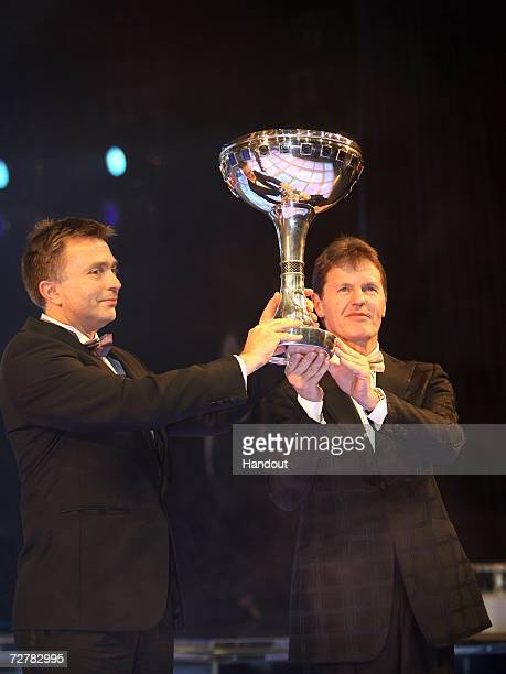 Jost Capito and Malcolm Wilson of Ford stand onstage with the FIA World Rally Championship Manufacturers trophy at the 2006 FIA Gala Prize Giving...