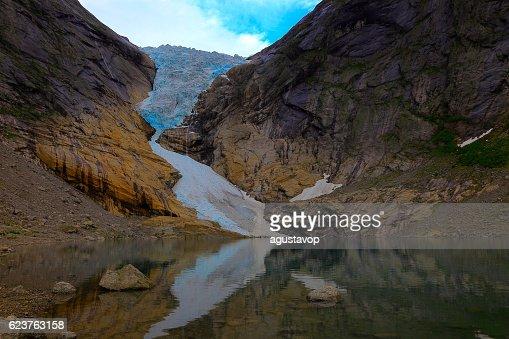 Jostedalsbreen paradise: Briksdal Glacier reflection sunset - Jostedal, Norway, Scandinavia