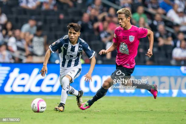 Josue Dominguez of Monterrey fights for the ball with Keisuke Honda of Pachuca during the 13th round match between Monterrey and Pachuca as part of...