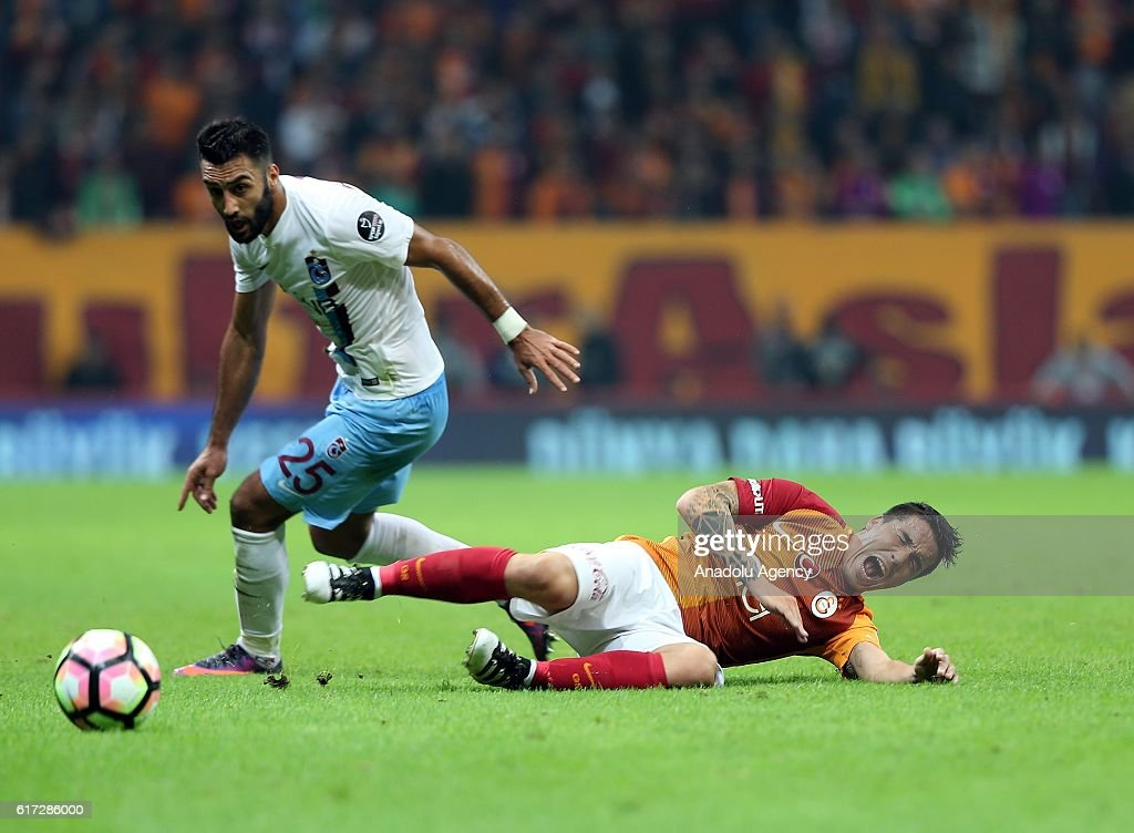 Josue (R) of Galatasaray in action during Turkish Spor Toto Super Lig match between Galatasaray and Trabzonspor at Turk Telekom Arena Stadium in Istanbul, Turkey on October 22, 2016.
