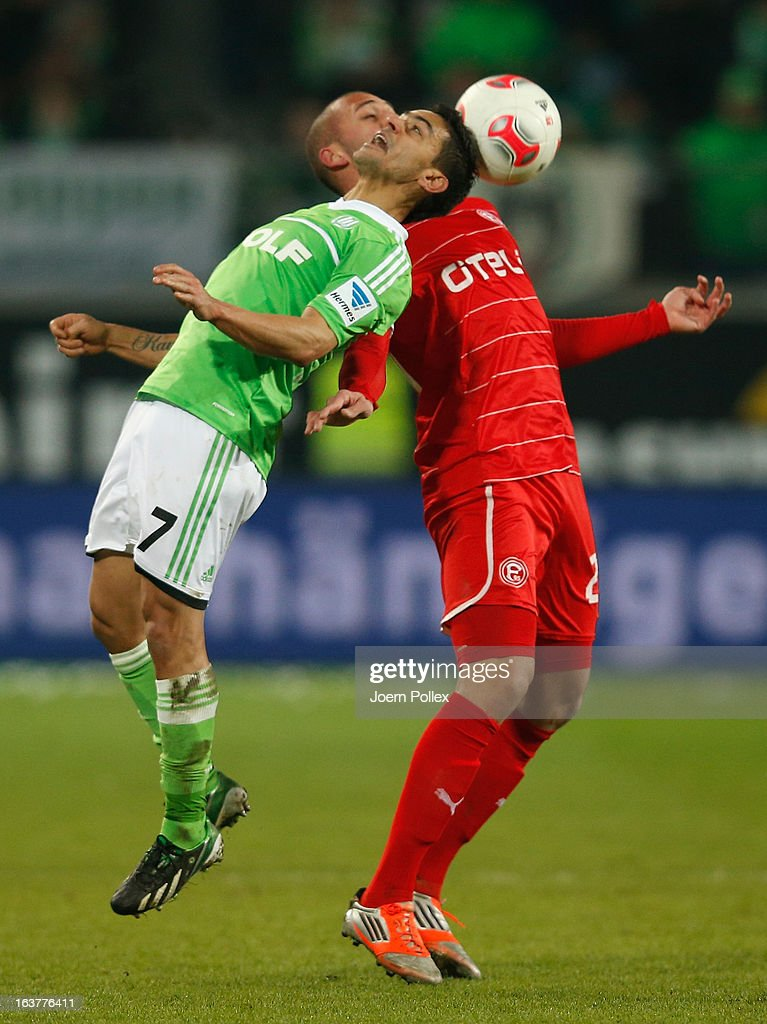 Josue (L) of Wolfsburg and Dani Schahin of Duesseldorf compete for the ball during the Bundesliga match between VfL Wolfsburg and Fortuna Duesseldorf 1895 at Volkswagen Arena on March 15, 2013 in Wolfsburg, Germany.