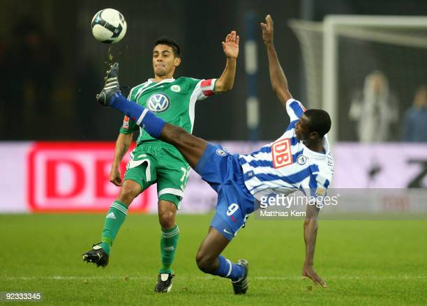 Josue of Wolfsburg battles for the ball with Adrian Ramos of Berlin during the Bundesliga match between Hertha BSC Berlin and VFL Wolfsburg at...