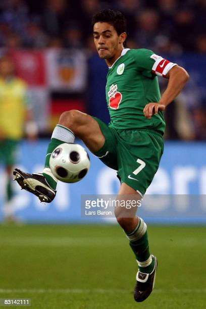 Josue of Wolfsburg runs with the ball during the Bundesliga match between FC Schalke 04 and VfL Wolfsburg at the Veltins Arena on October 5 2008 in...