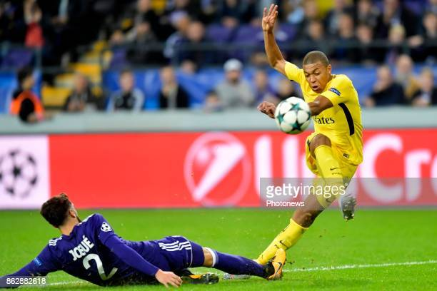 Josue Sa defender of RSC Anderlecht battles for the ball with Kylian Mbappe forward of PSG during the Champions League Group B match between RSC...