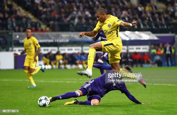 Josue Sa of RSC Anderlecht attempts to tackles Kylian Mbappe of PSG during the UEFA Champions League group B match between RSC Anderlecht and Paris...