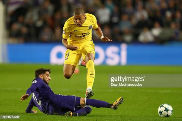 Josue Sa of RSC Anderlecht tackles Kylian Mbappe of PSG during the UEFA Champions League group B match between RSC Anderlecht and Paris SaintGermain...