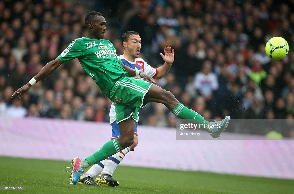 Josuha Guilavogui of Saint-Etienne and <a gi-track='captionPersonalityLinkClicked' href=/galleries/search?phrase=Steed+Malbranque&family=editorial&specificpeople=206647 ng-click='$event.stopPropagation()'>Steed Malbranque</a> of Lyon in action during the Ligue 1 match between Olympique Lyonnais, OL, and AS Saint-Etienne, ASSE, at the Stade Gerland on April 28, 2013 in Lyon, France.