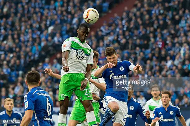 Josuha GUILAVOGUI of VfL Wolfsburg and KlaasJan HUNTELAAR of Schalke 04 battle for the ball during the Bundesliga match between FC Schalke 04 and VfL...