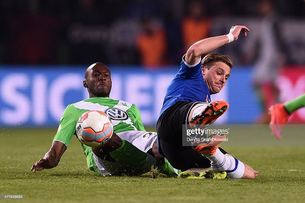 Josuha Guilavogui of VfL Wolfsburg challenges Tom Schuetz of Arminia Bielefeld during the DFB Cup Semi Final match betwen Arminia Bielefeld and VfL Wolfsburg at Schueco Arena on April 29, 2015 in Bielefeld, Germany.