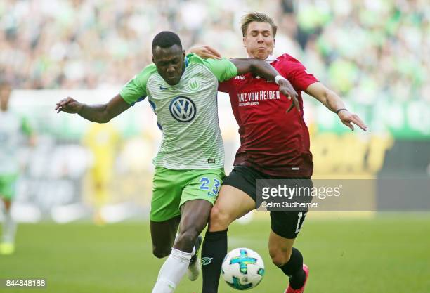 Josuha Guilavogui of VfL Wolfsburg fights for the ball with Felix Klaus of Hannover 96 during the Bundesliga match between VfL Wolfsburg and Hannover...