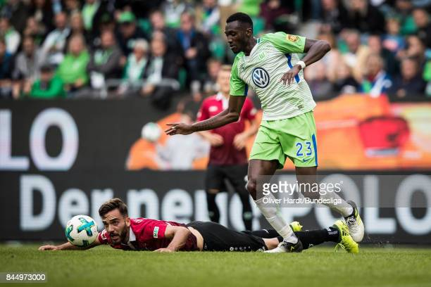 Josuha Guilavogui of Wolfsburg and Kenan Karaman of Hannover compete for the ball during the Bundesliga match between VfL Wolfsburg and Hannover 96...