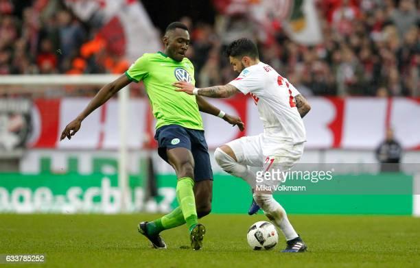 Josuha Guilavogui of Wolfsburg challenges Leonardo Bittencourt of Cologne during the Bundesliga match between 1 FC Koeln and VfL Wolfsburg at...